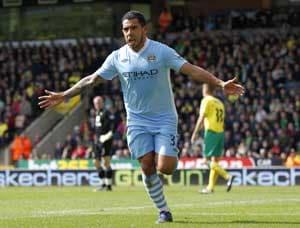 Carlos Tevez treble routs Norwich as Manchester City boost title bid