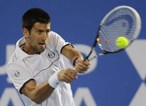 Novak Djokovic overcomes foot scare to win in Shanghai