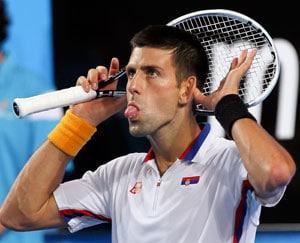 Djokovic dodges injury as Serbia thrash Italy