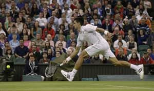 Djokovic eases past Troicki to reach quarterfinals