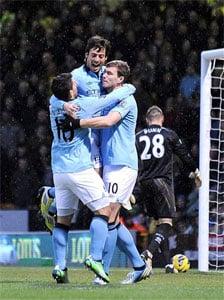 Samir Nasri off but Dzeko double fires Manchester City