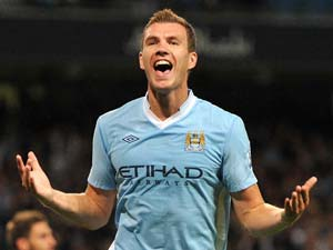 Man City boss Mancini receives apology - from Dzeko