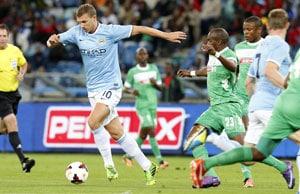 Edin Dzeko's brace powers Manchester City past AC Milan