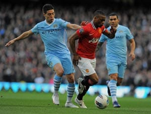 Manchester City looks to delay Manchester United's coronation in derby