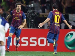 UEFA Champions League: Lionel Messi scores twice as Barcelona beat AC Milan 3-1