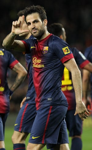 Cesc Fabregas will stay at Barcelona, says teammate Pique