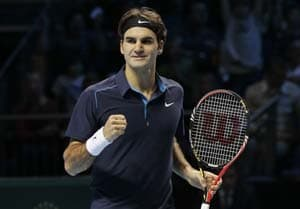 Roger Federer into Basel quarters after fight-back