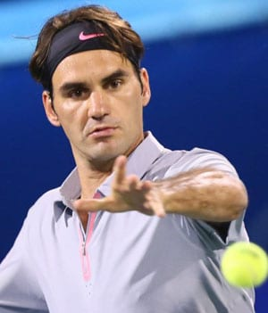 Roger Federer eases into Halle quarters on grass return