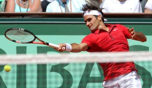 Record-setting Federer into French Open quarters