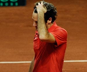 Federer crashes to shock Davis Cup defeat