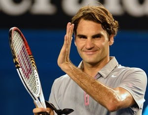 Roger Federer sets up Bernard Tomic showdown with easy win