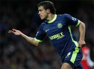 Wigan stun Arsenal to ease relegation worries