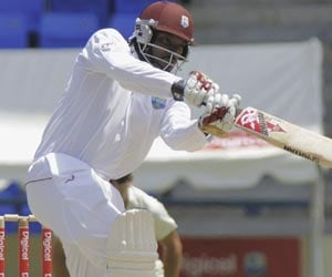 Chris Gayle storms to half-century on return