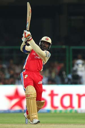 IPL 2013: Chris Gayle blows away KKR as RCB go to top