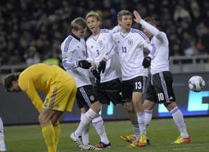 Youthful Germans survive Ukraine scare in friendly