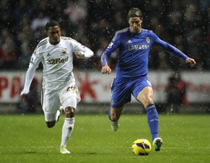 Chelsea loses top spot after 1-1 draw at Swansea