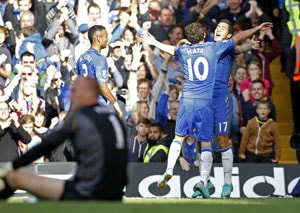 Four star Chelsea cement top spot after Norwich rout