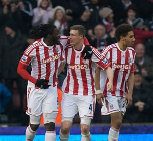 Huth powered Stoke City see off comeback kings Reading