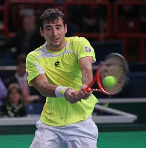 Dodig beats Tomic in first round at Memphis