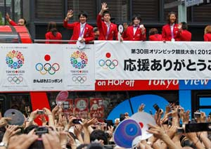 Olympics: Japanese medalists return to rousing celebration