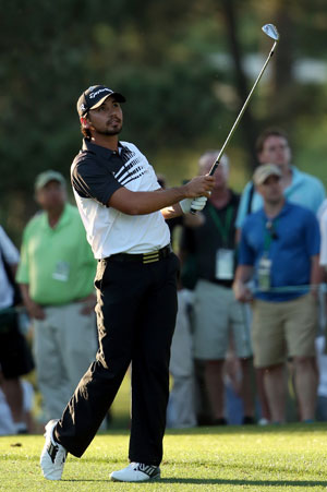 Jason Day leads Masters as Tiger stumbles and Guan plays on