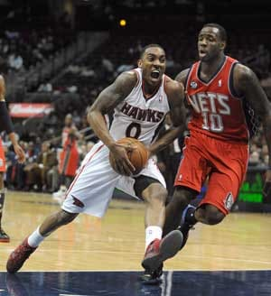 Teague, Johnson lead Hawks past Nets