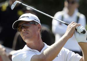 Senden sizzles as Tiger falters at Australian Open