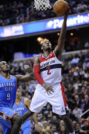 Wall, Young help Wizards break Thunder streak