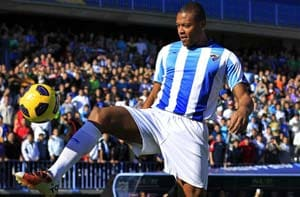 Baptista sends battling Malaga top in Spain