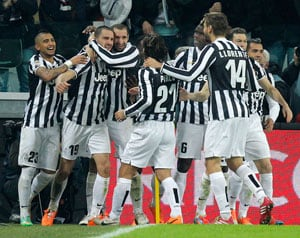 Serie A: Juventus go eight points clear after routing nine-man Roma