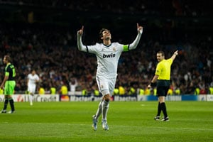Real Madrid hit four as Ajax crumble