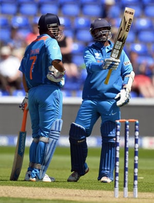 Champions Trophy 2013: MS Dhoni mulls batting options after Dinesh Karthik 'seals' spot