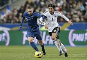 Muller and Khedira score as Germany beats France