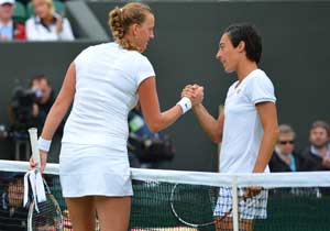 Champion Kvitova into Wimbledon quarters