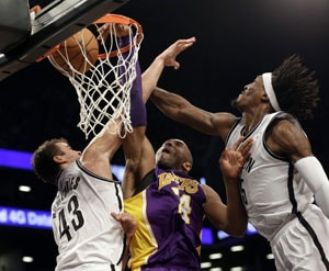 Short-handed Los Angeles Lakers beat Brooklyn Nets 92-83