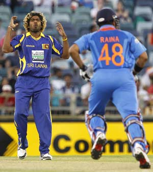 ICC World Twenty20: Lasith Malinga takes four wickets as India lose by 5 runs to Sri Lanka in warm-up