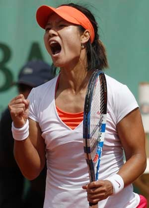 Li Na storms into fourth round