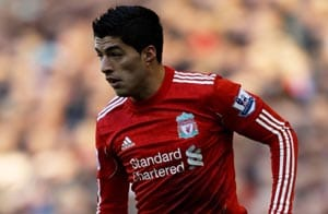 Luis Suarez salutes fans on Anfield return