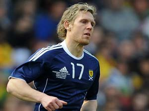 Scotland win to keep Euro 2012 hopes alive