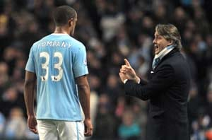 Manchester City skipper Kompany moves to end Mancini row