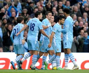 Man City maintain lead as brave Wolves downed
