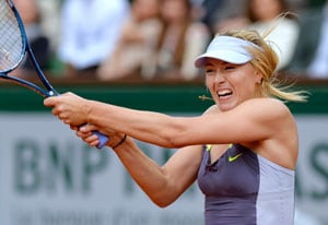 Maria Sharapova sees off battling Zheng Jie at French Open