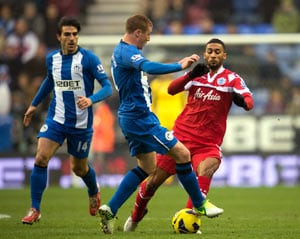 Wigan holds QPR to 2-2 draw in Premier League