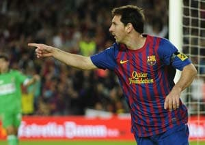 Messi brace ensures Barcelona stay on top