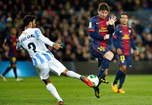 10-man Malaga holds Barcelona 2-2 in Copa del Rey