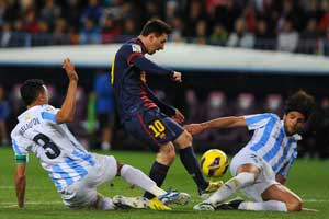 Lionel Messi does it all for Barcelona as Malaga suffer