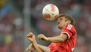 Thomas Mueller hat-trick eases Cup holders Bayern through
