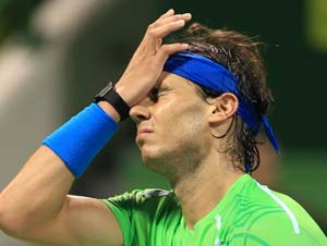 Injured Federer, beaten Nadal out of Qatar Open