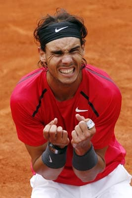 Rafael Nadal happy to suffer in pursuit of eighth French Open title