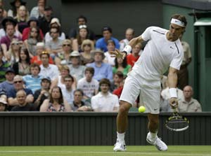 Rafael Nadal survives scare to ease into Wimbledon second round